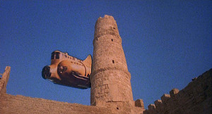 "The ultimate ""Deus ex machina"" gimmick in Monty Python's Life of Brian.  Brian plummets from the tower, and seconds from certain death, he is rescued by an alien spaceship that just happens to be flying by."